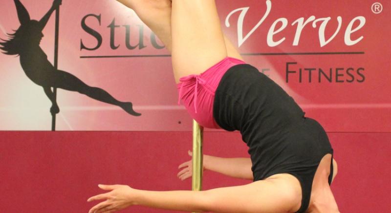 "Studio Verve student Christina holding an Intermediate pole skill called ""The Hooked Leg Layback"""