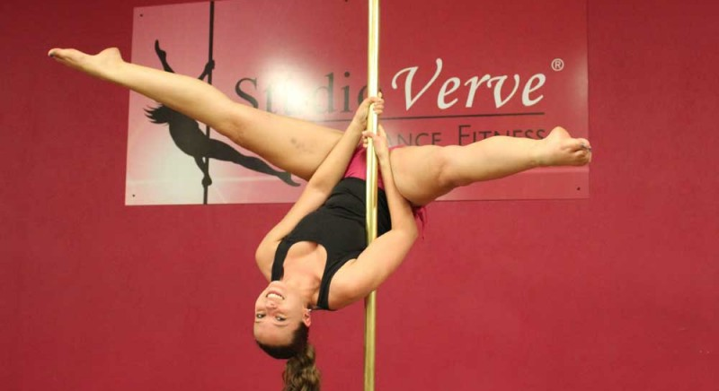 "Studio Verve student Christina holding an Intermediate pole skill called ""The Inverted V"""