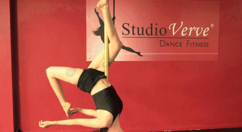 High Intermediate student Samantha demonstrating a Leg Hang