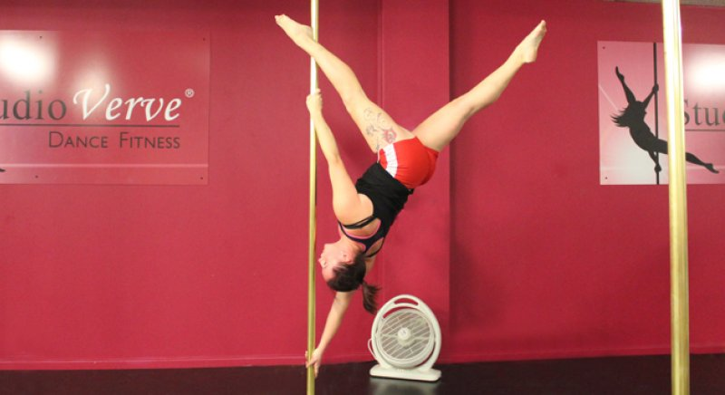 """PoleFit student Chelsea Booth demonstates an Advanced Pole Dance skill called """"Extended Butterfly"""""""