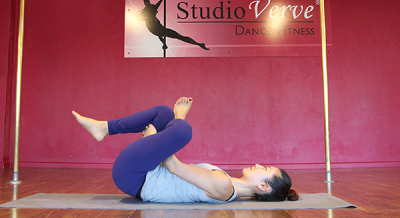 Student Nadine demonstrates a basic hip opener stretch called Thread The Needle