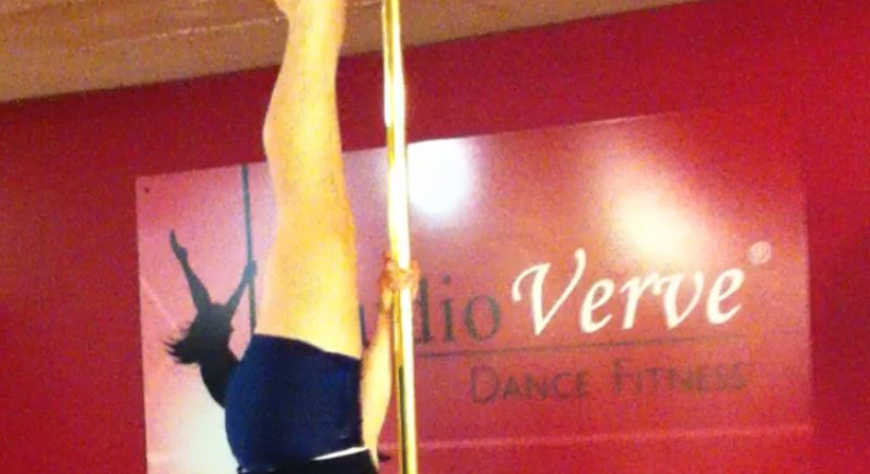 "PoleFit student Chelsea Booth demonstates an Advanced Pole Dance skill called ""Inverted Pencil"""