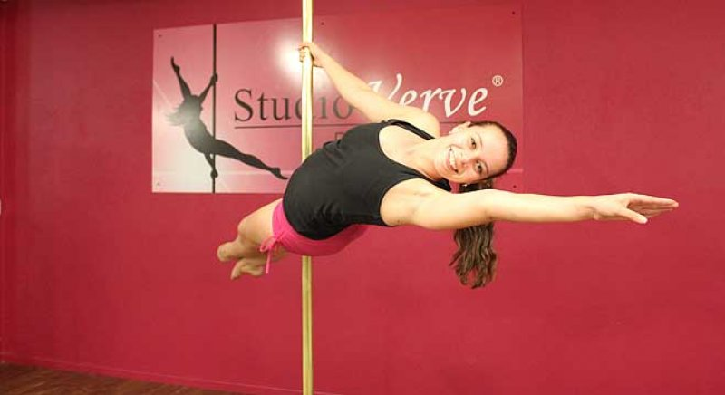 "Studio Verve student Christina holding an Intermediate pole skill called ""The Showgirl"""
